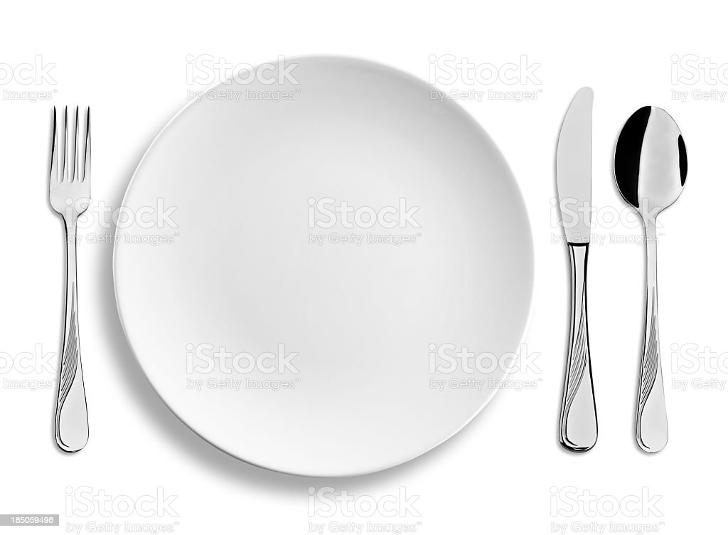 Empty dinner plate with steel cutlery isolated on white background stock photo