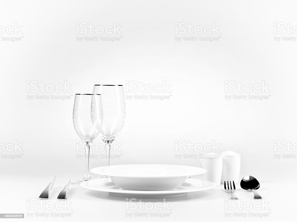 empty dinner setup with plate fork and meat knife stock photo