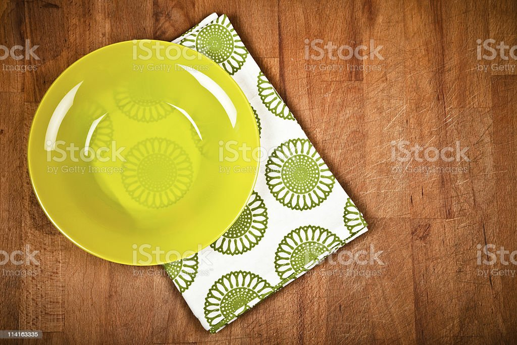 Empty dish and napkins on chopping board stock photo