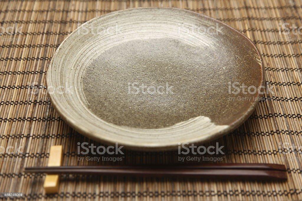 empty dish with chopsticks stock photo