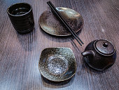 Empty dishes for sushi and rolls on a kitchen table.
