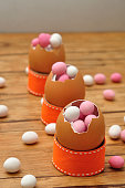 Empty egg shells filled with pink and white candy