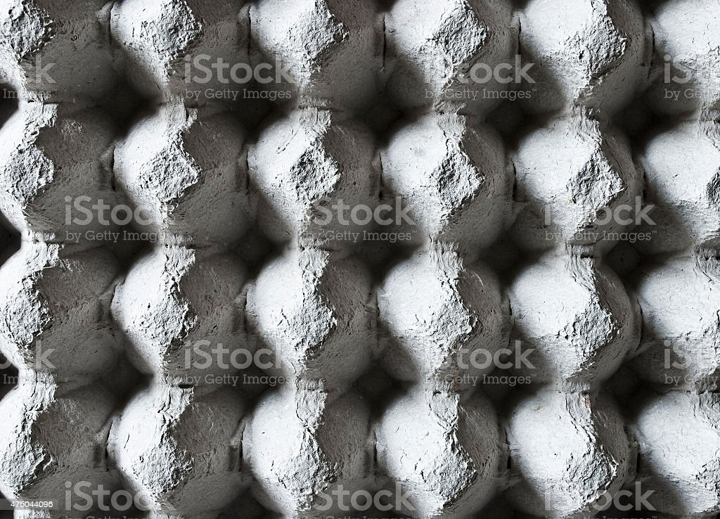 Empty eggs container background or texture. stock photo