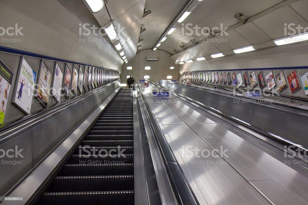 Empty escalator deep in the London Underground, UK. stock photo