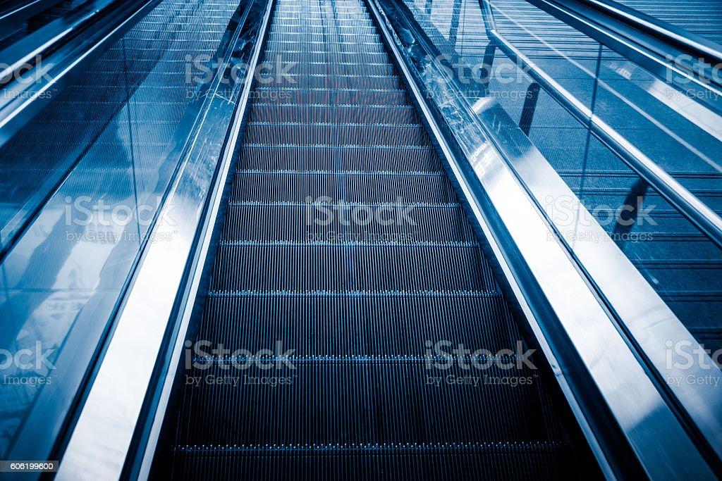 Empty Escalator In Modern Building stock photo