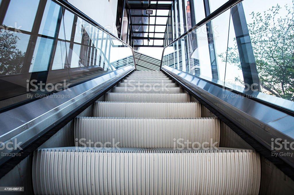 Empty escalator stairs stock photo