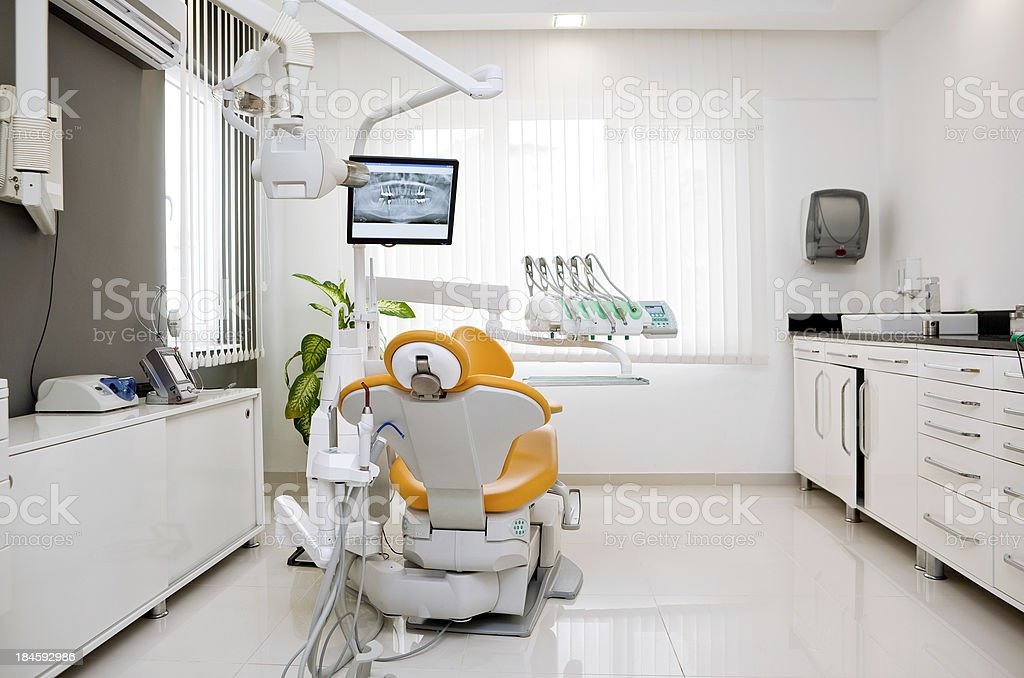 Empty exam room at dentist's office royalty-free stock photo