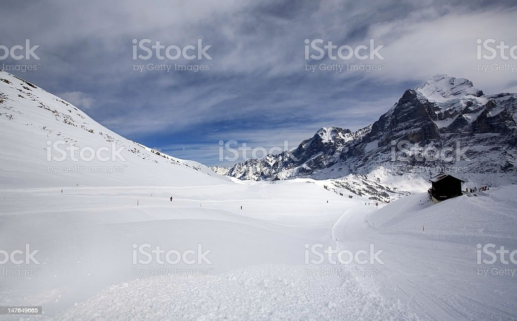 Empty field of snow with small hut royalty-free stock photo