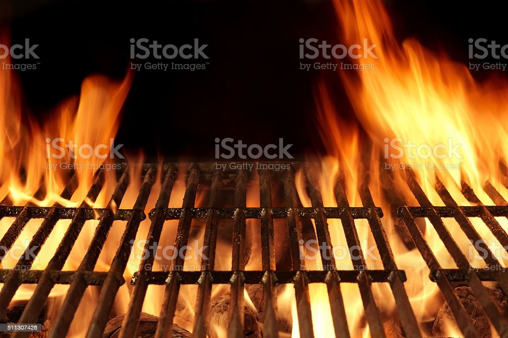 Empty Flaming Barbecue Grill Isolated On Black Background. Top V stock photo