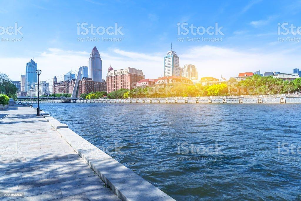 empty floor and city skyline under blue sky stock photo