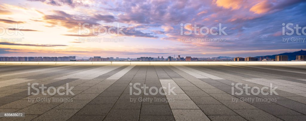 empty floor and cityscape of modern city against cloud sky stock photo