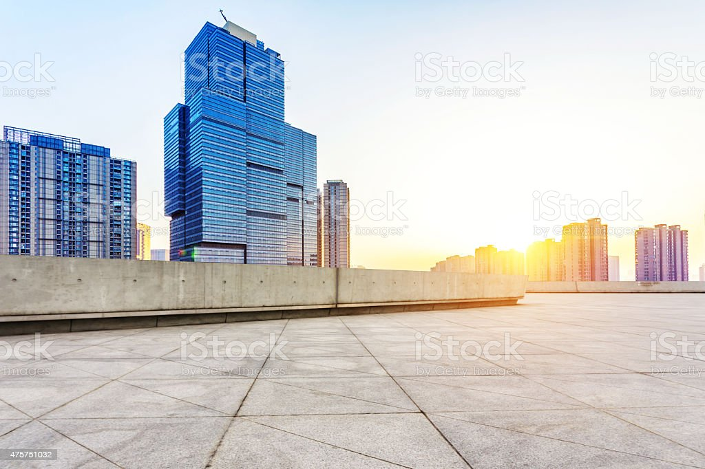 Empty floor and modern building with sunbeam stock photo
