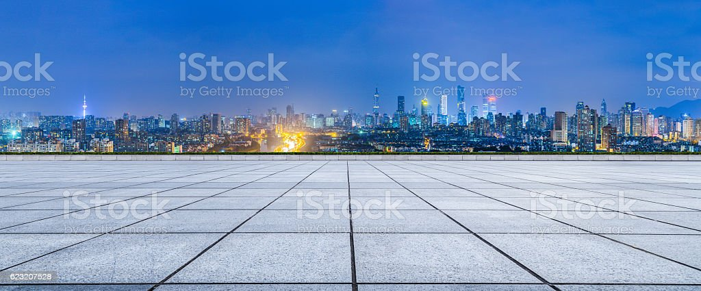 Empty floor and modern city skyline in Nanjing at night stock photo