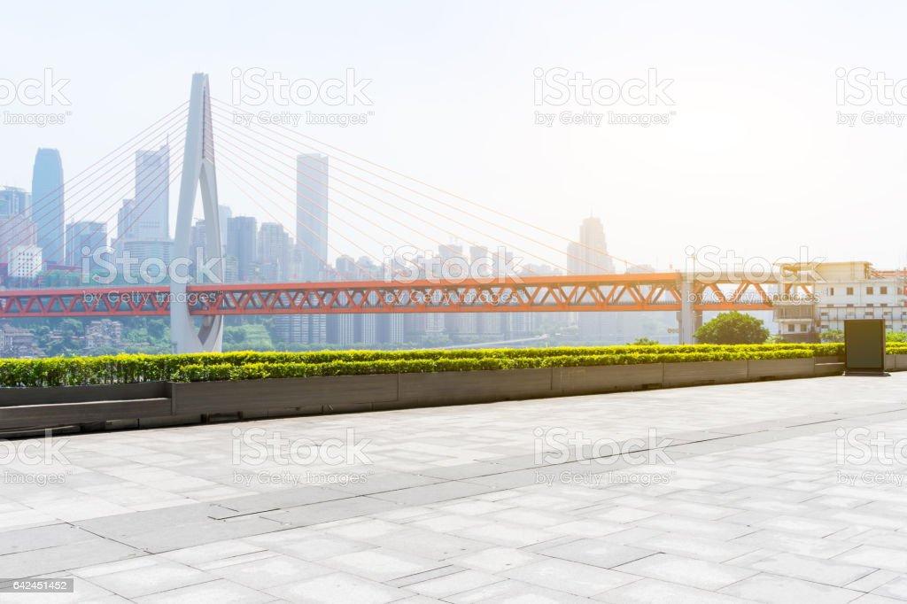 empty floor with bridge and modern buildings stock photo