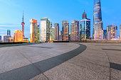 Empty floor with modern skyline at sunset in Shanghai