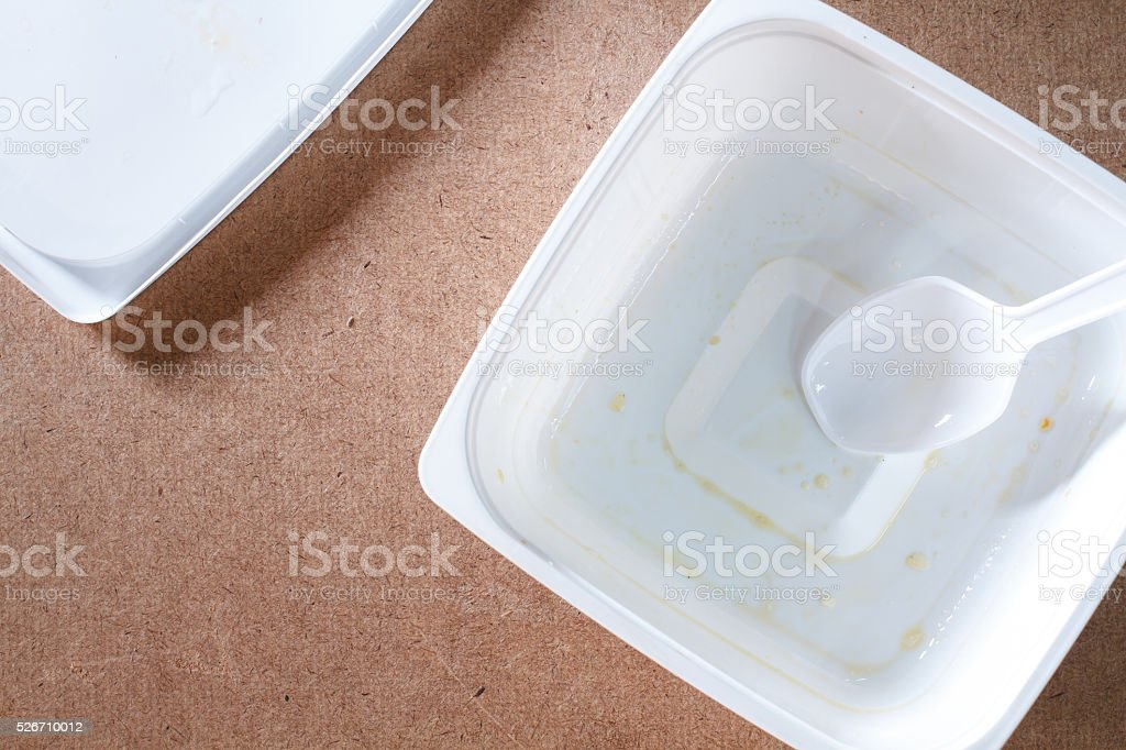 Empty food container on wood background.Top view stock photo