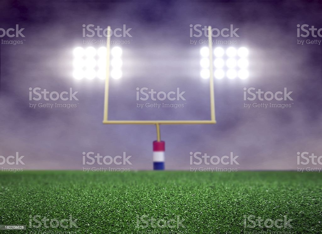 Empty Football Field and Spotlights stock photo