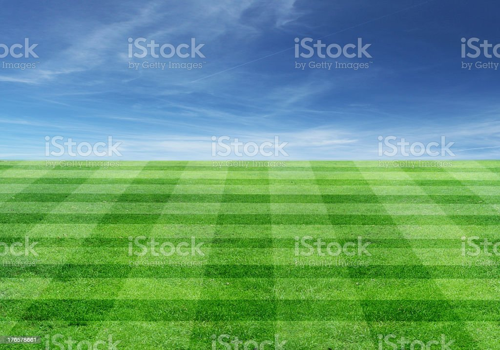 Empty football field with clear blue sky stock photo