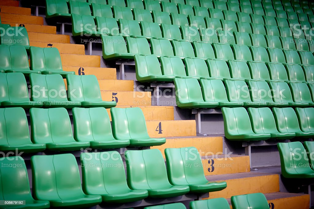 Empty football stadium chairs stock photo