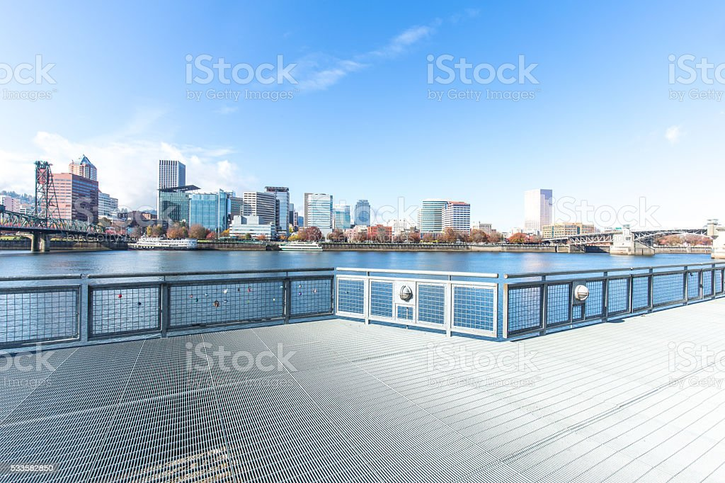 empty footpath on bridge with cityscape and skyline of portland stock photo
