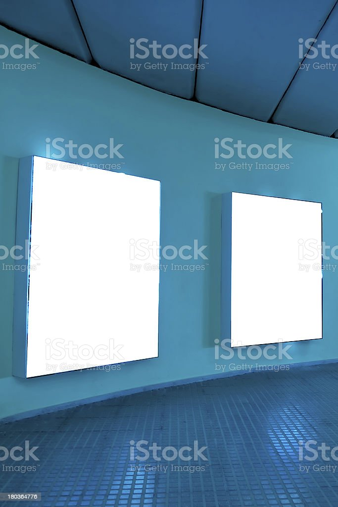 empty frames on blue wall royalty-free stock photo