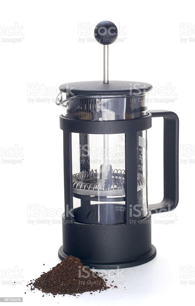 Empty french press with ground coffee royalty-free stock photo