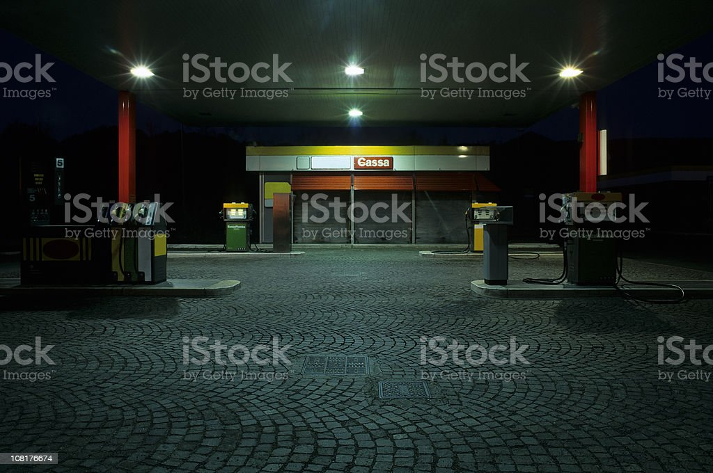 Empty Gas Station at Night stock photo