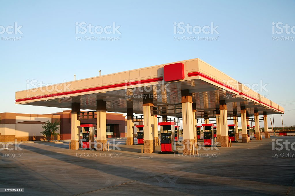Empty gas station in front of store stock photo