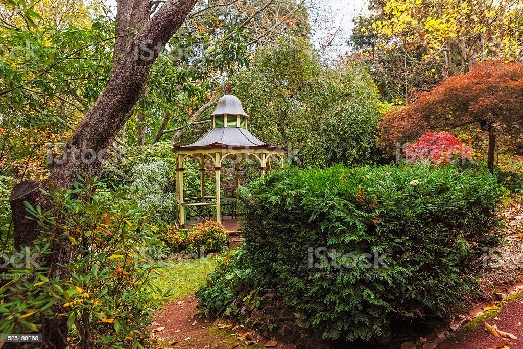 Empty gazebo in fall garden stock photo