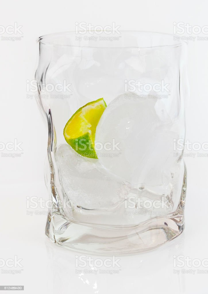 Empty Glass Alcohol Cocktail with Lime and Ice stock photo