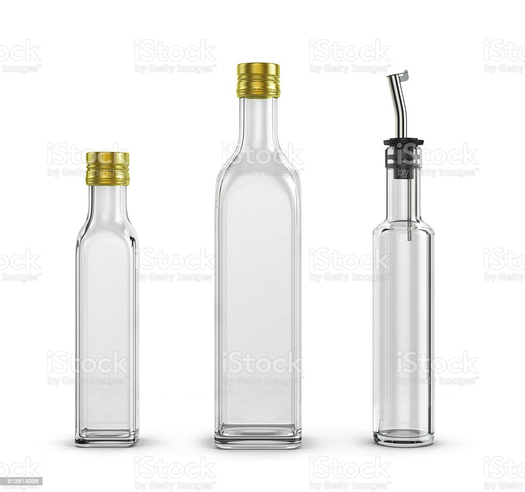 empty glass bottles for olive oil of different sizes isolated stock photo