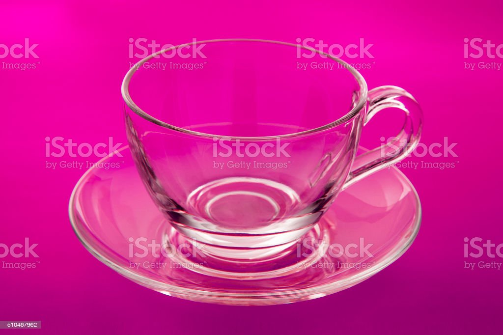 Empty glass cup and saucer stock photo