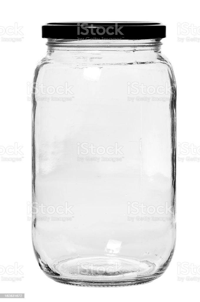 A empty glass jar on a white background stock photo
