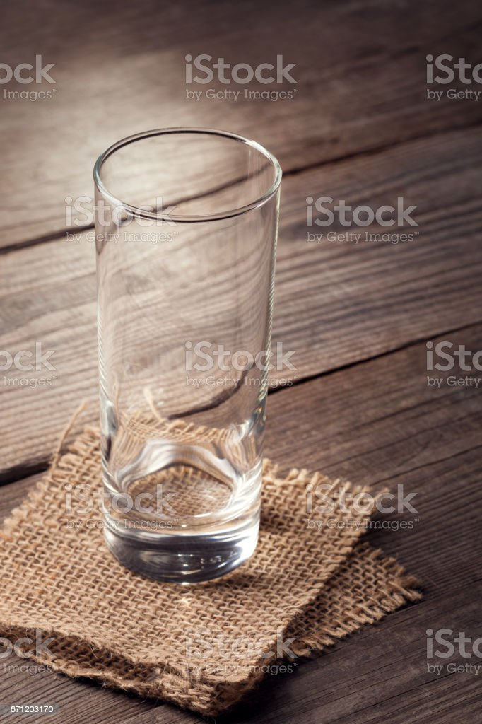 Empty glass on a wooden table stock photo