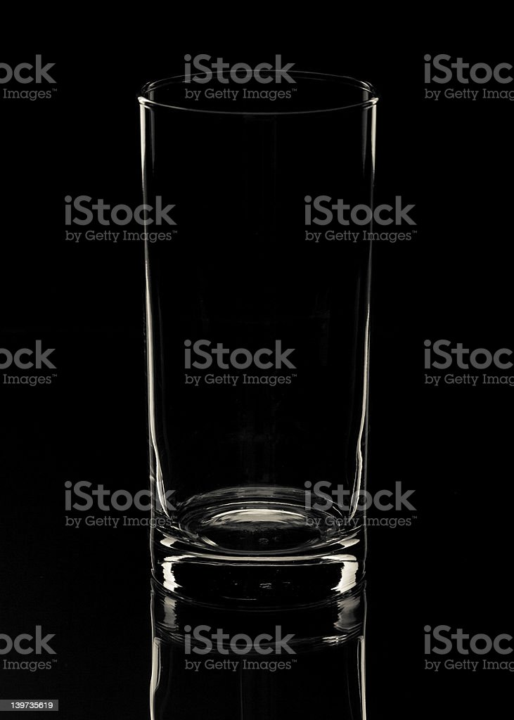 Empty glass on black backdrop with reflection royalty-free stock photo