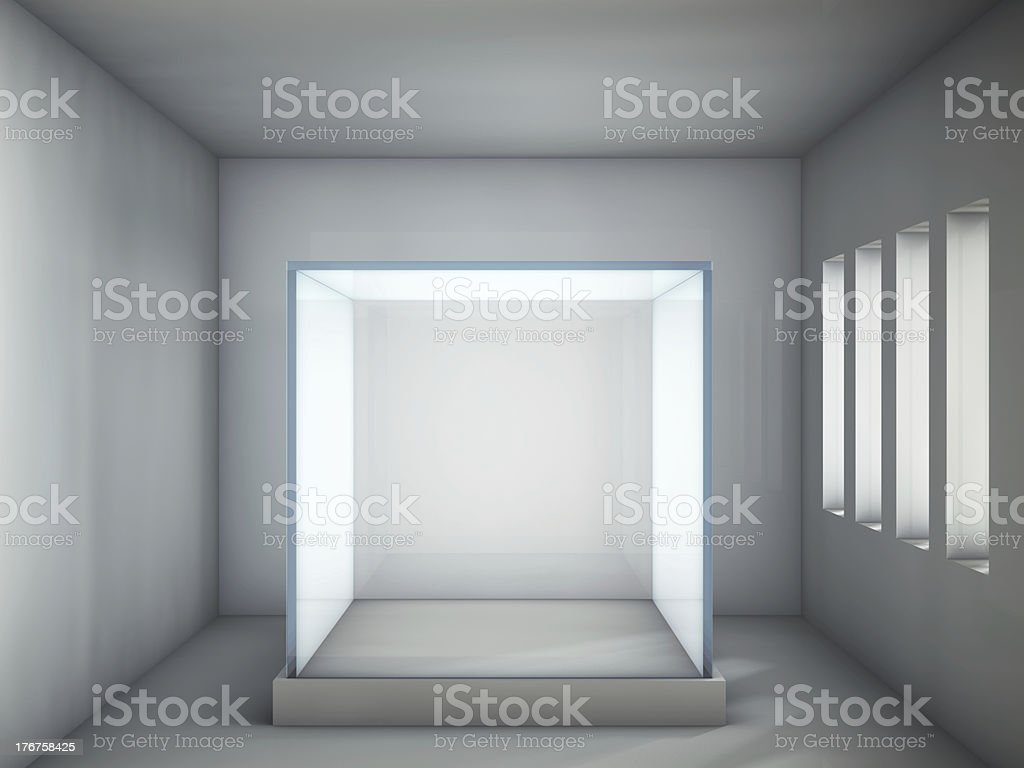 Empty glass showcase in grey room royalty-free stock photo