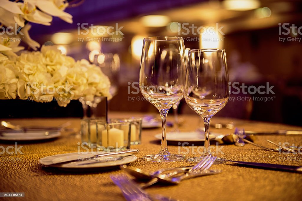 Empty glasses and dishes set in luxury restaurant stock photo