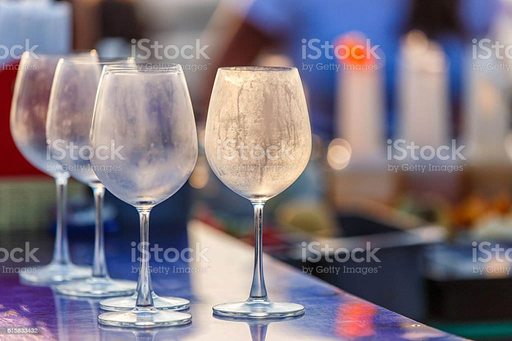 Empty glasses for wine on the table at counter bar stock photo