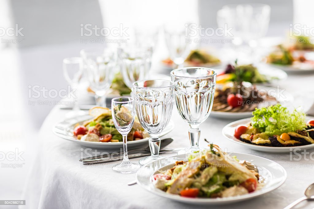 Empty glasses  in restaurant. Banquet table set stock photo