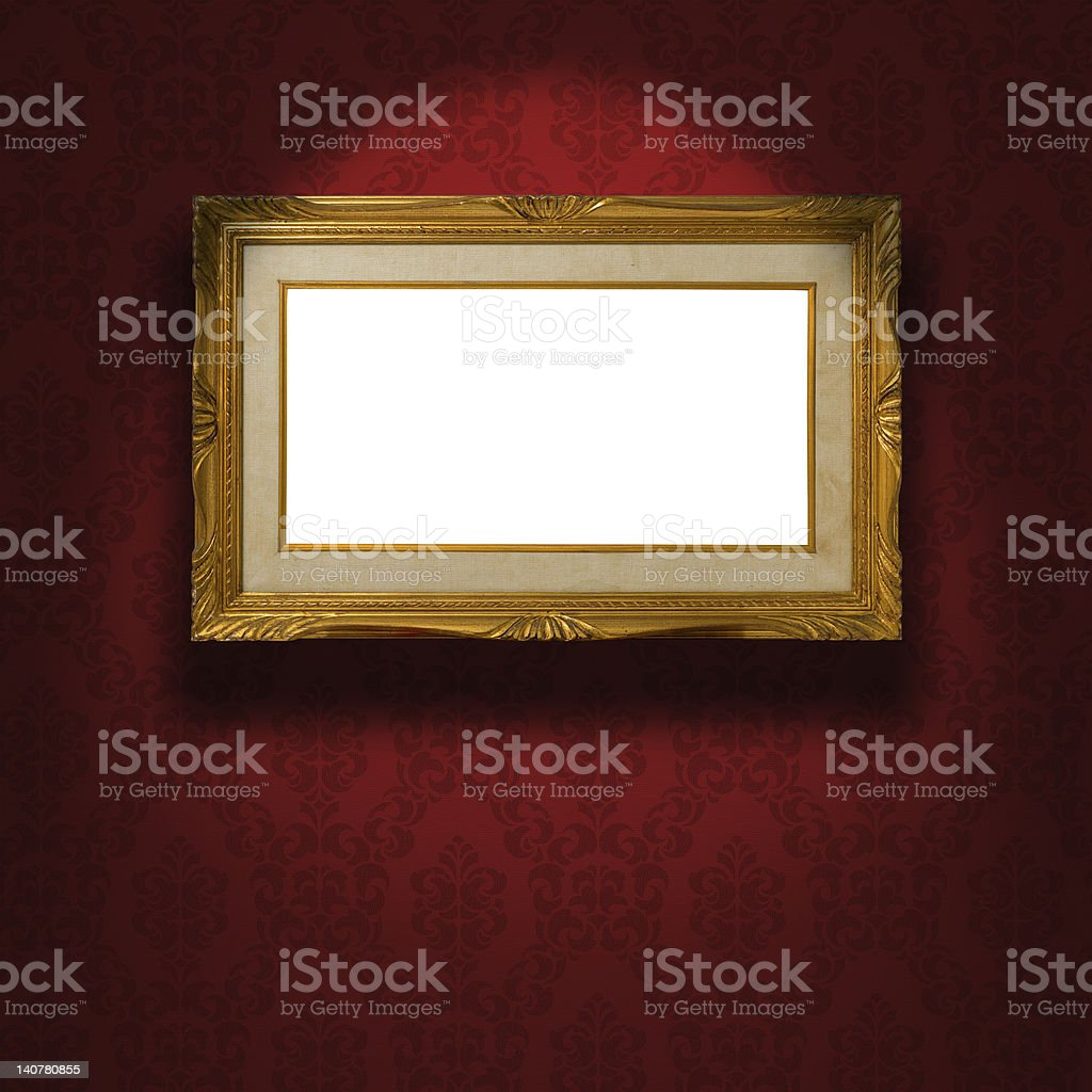 Empty golden frame on the wall. stock photo