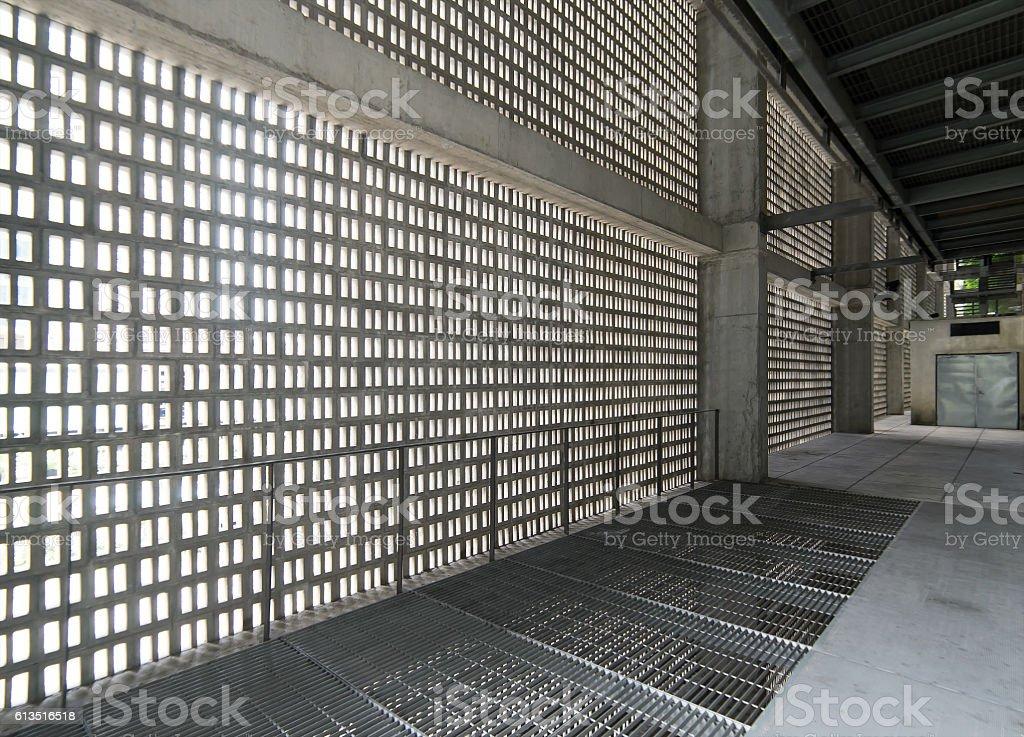 Empty gray concrete corridor stock photo