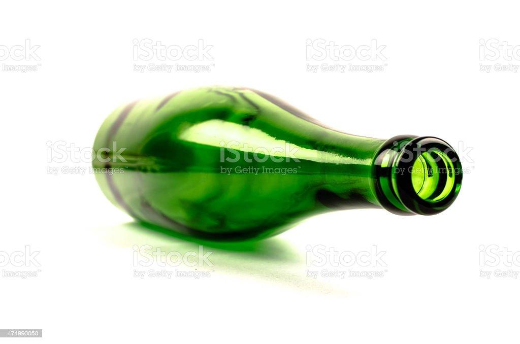Empty green bottle on white background - lying stock photo