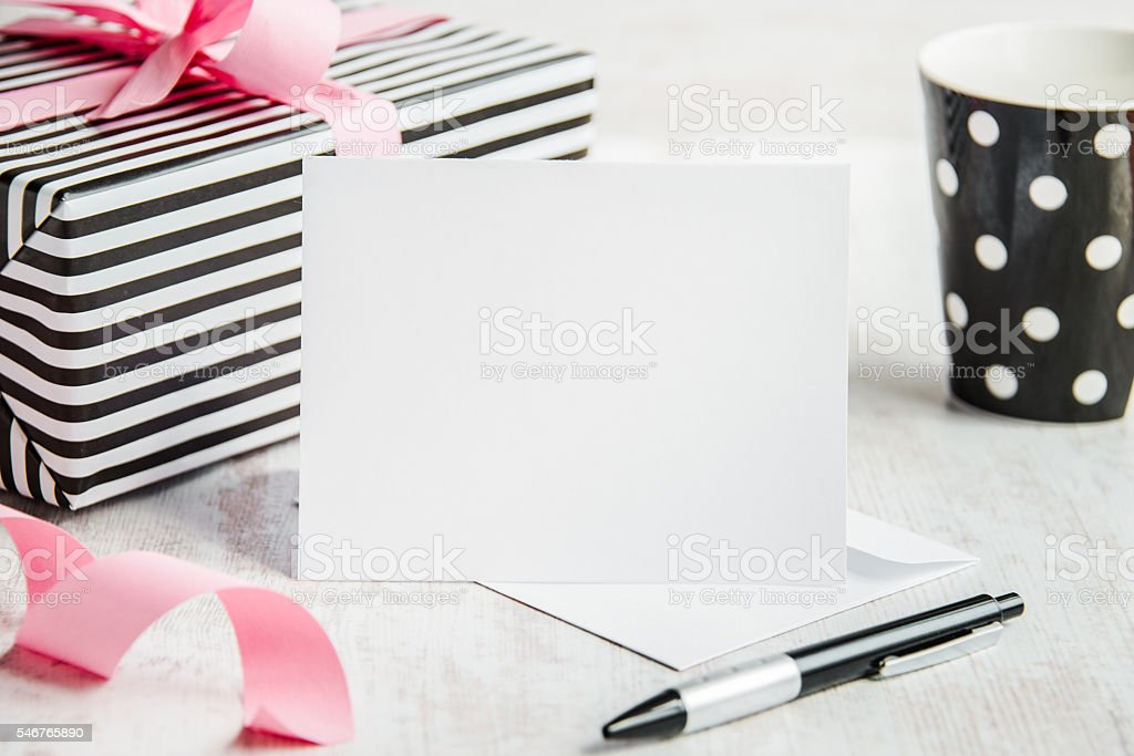 Empty greeting card. Wrapped gift and coffee cup stock photo
