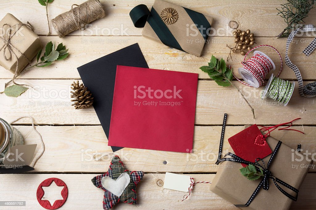 empty greeting cards and Christmas ornaments on wooden backgroun stock photo
