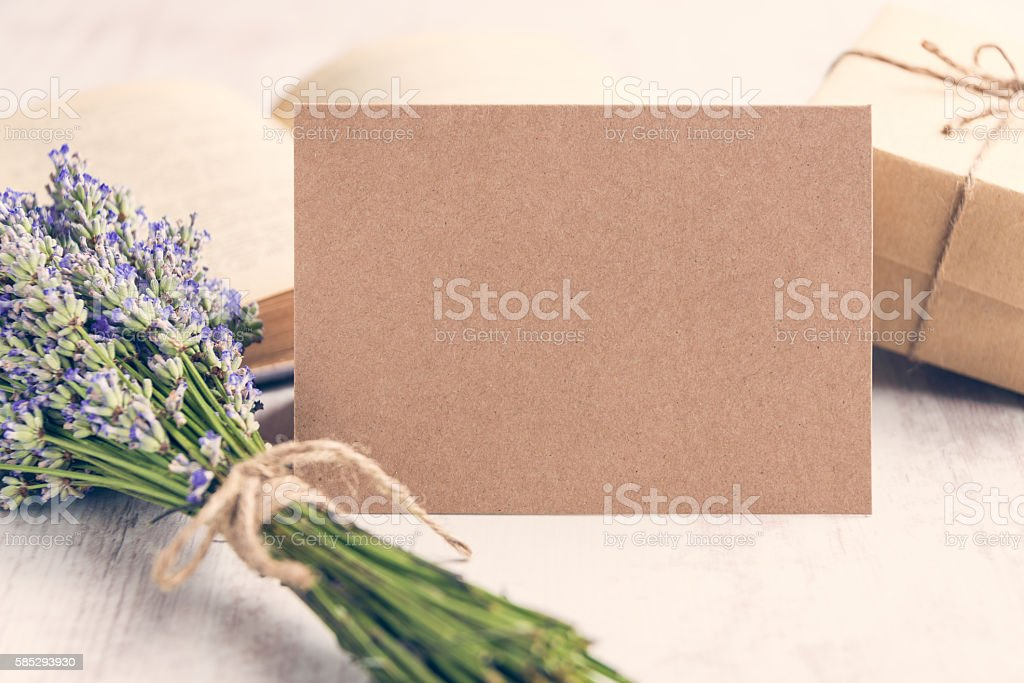 Empty greeting kraft card in front of a lavender bouquet stock photo