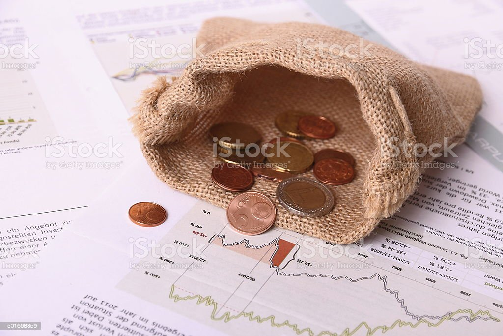 Empty gunny euro sack on worthless Invest papers royalty-free stock photo