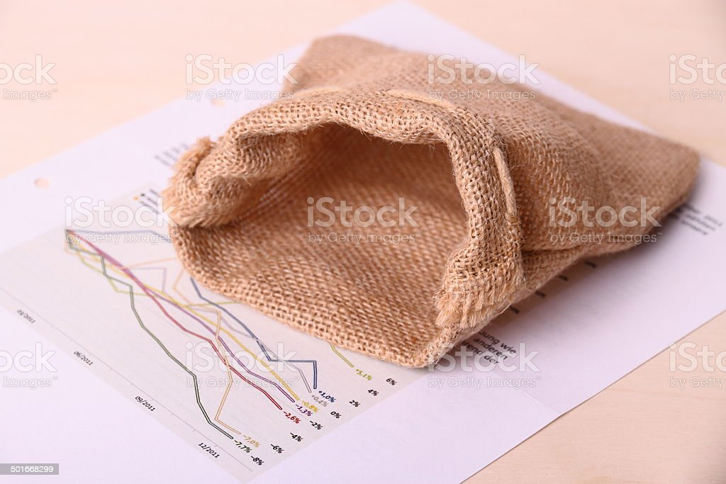 Empty gunny sack on worthless Invest papers royalty-free stock photo