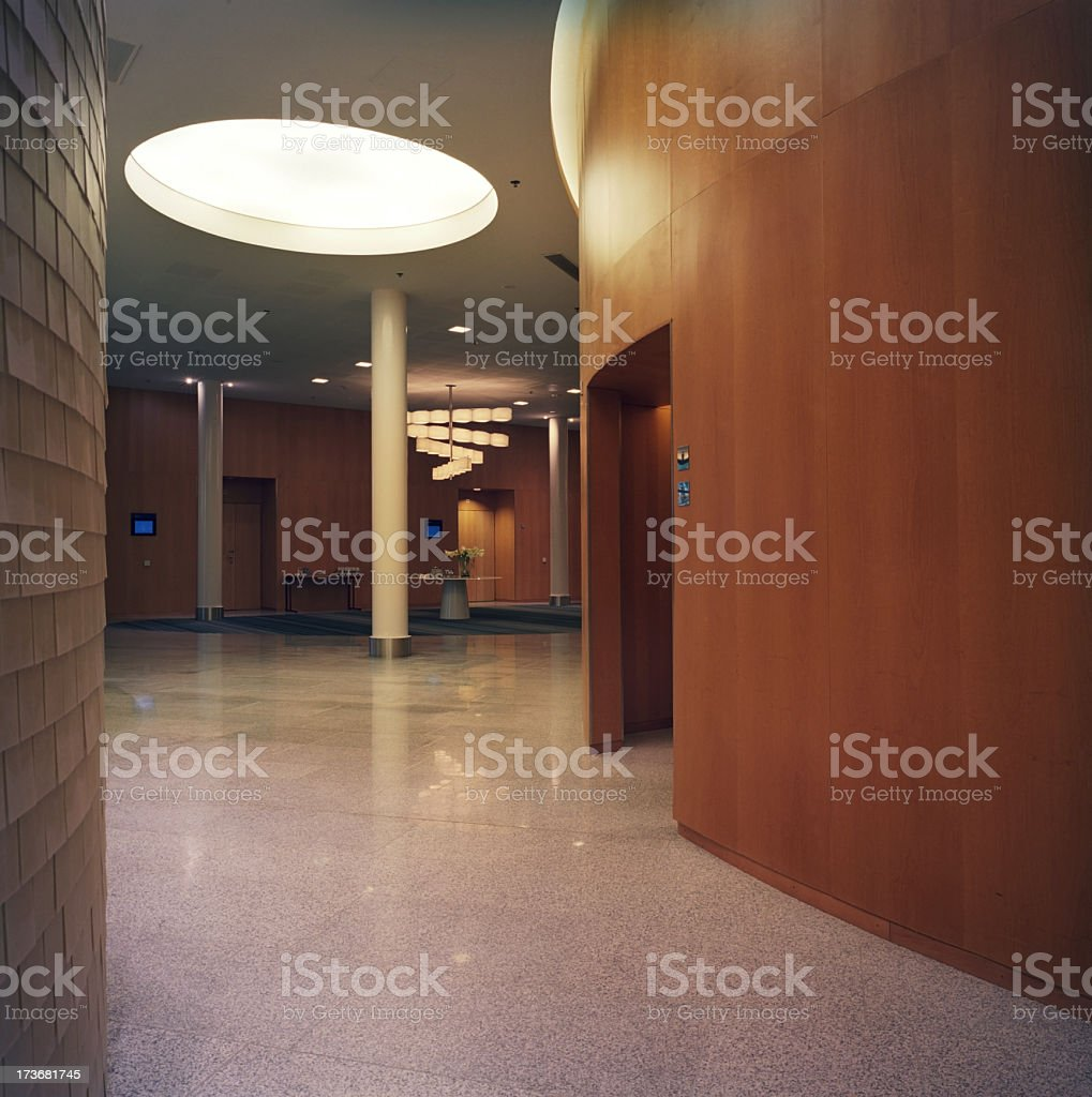 Empty hallways with wooden panel walls and large light royalty-free stock photo