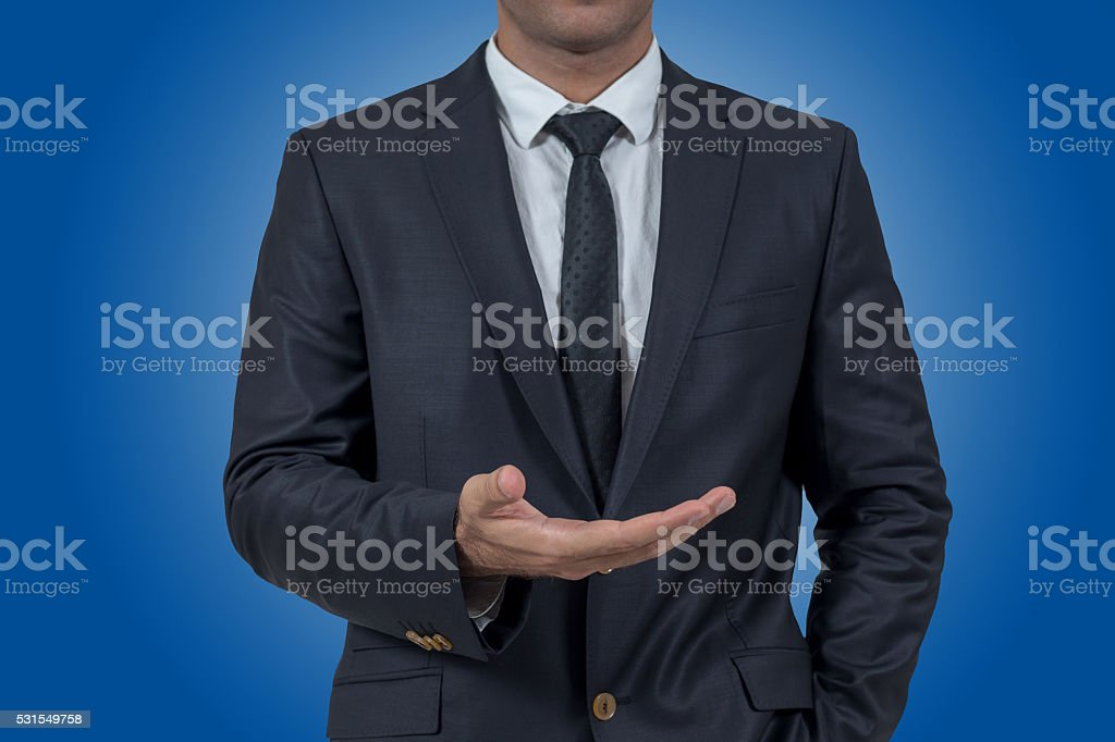 Empty hand of businessman on blue background stock photo