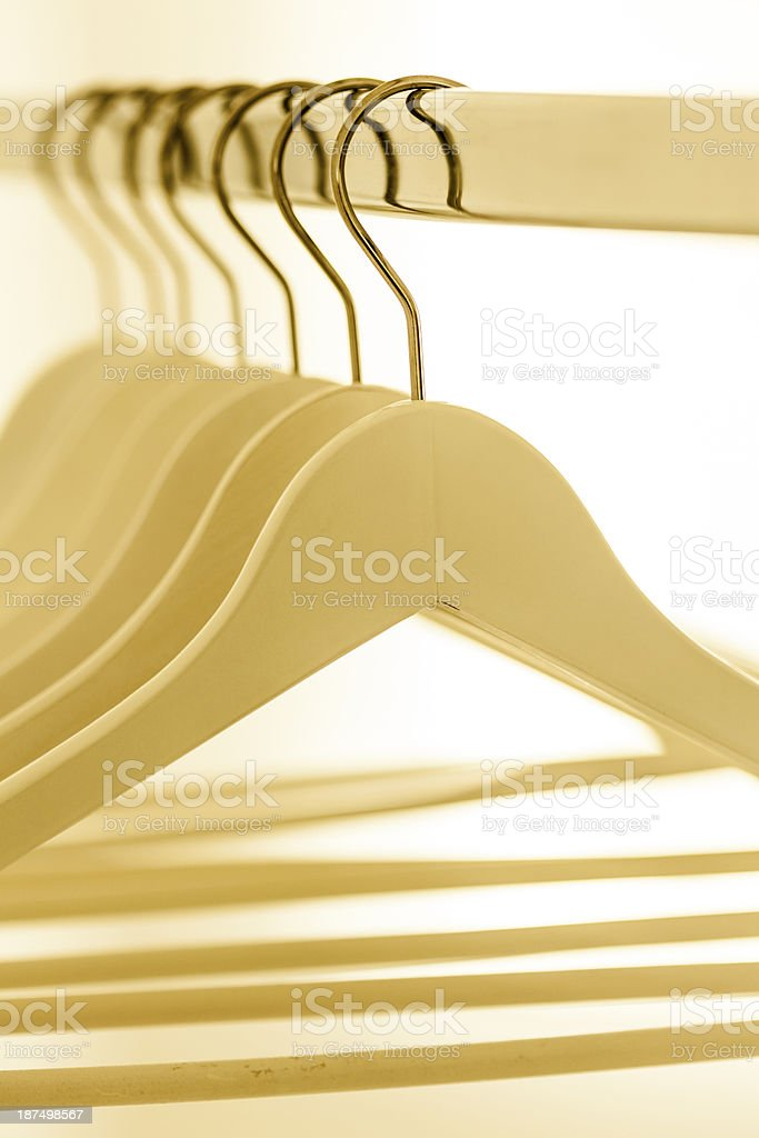 Empty hangers on blue royalty-free stock photo